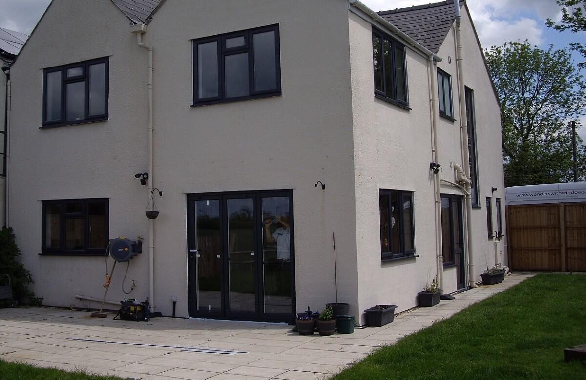 Anthracite Grey PVCu Windows and Aluminium Bi-folding Door
