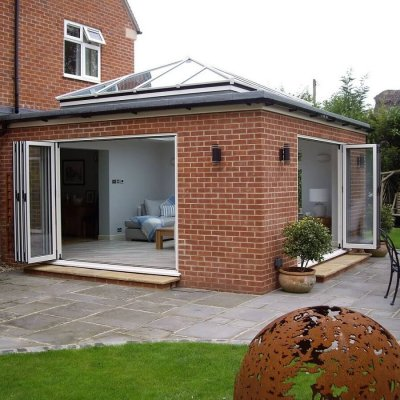 Atlas roof above dual aspect bi-folding doors