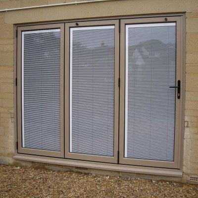 Bespoke RAL colour bi-folding doors with integral blinds