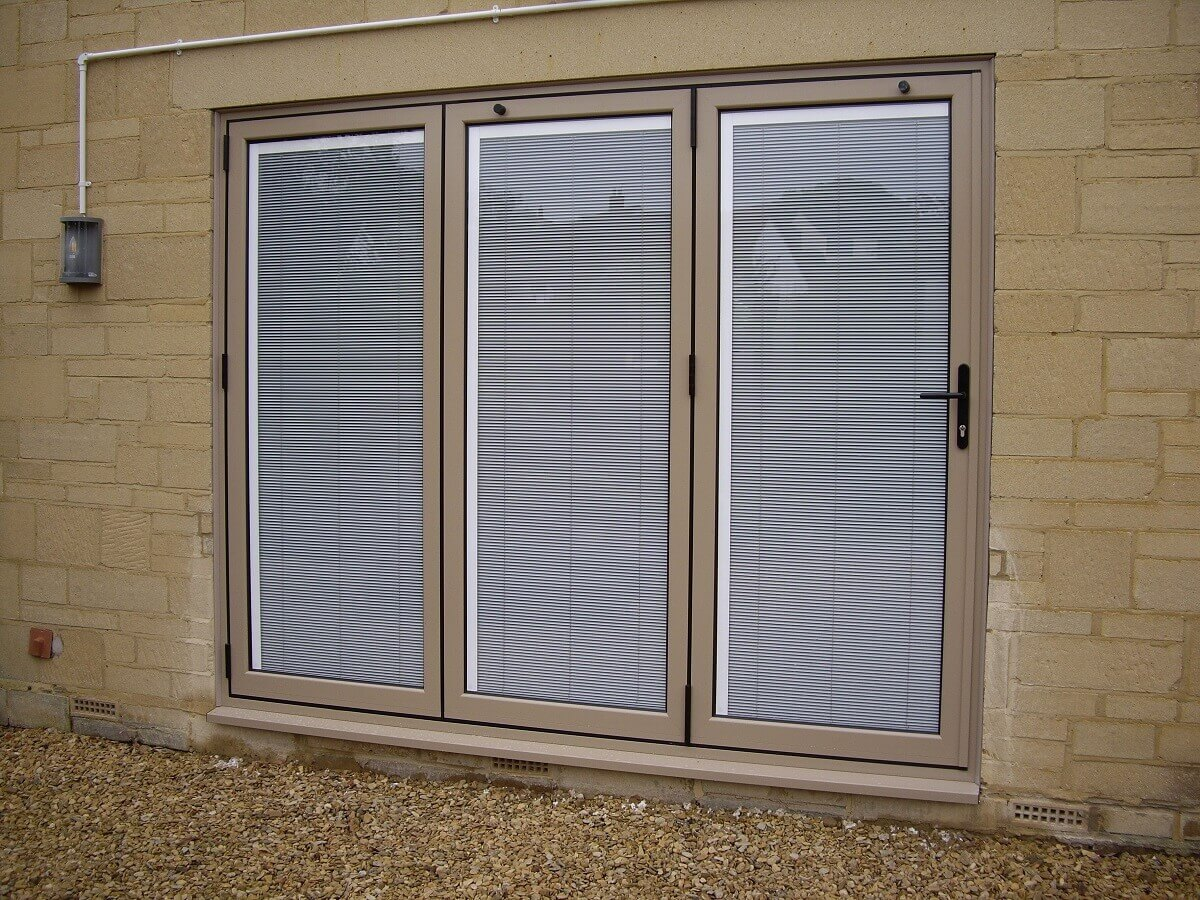 Bespoke RAL colour bi-folding doors with integral blinds