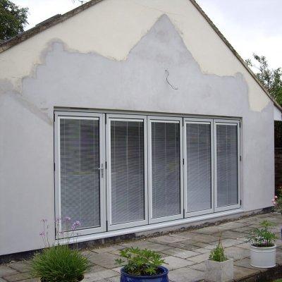 Bespoke RAL coloured aluminium bi-folding doors with integral blinds