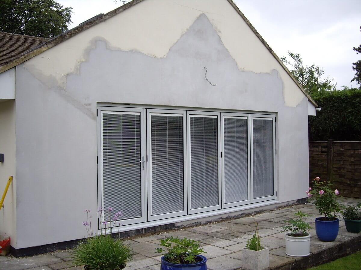 Bespoke RAL coloured aluminium bi-folding doors with integral blinds