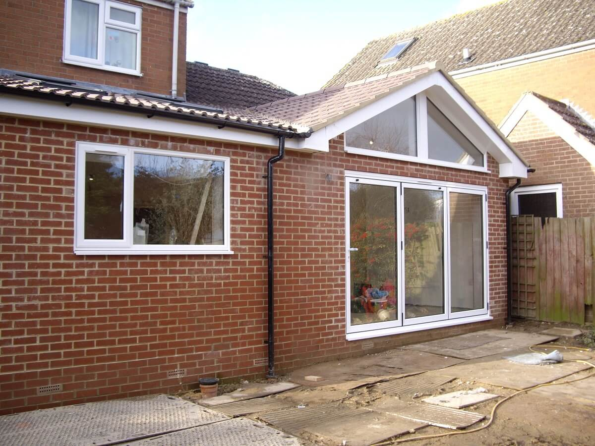 Bi-folding doors with shaped frames resized