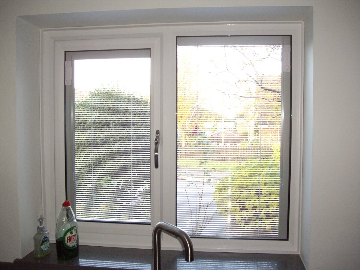 Casement window with integral blinds