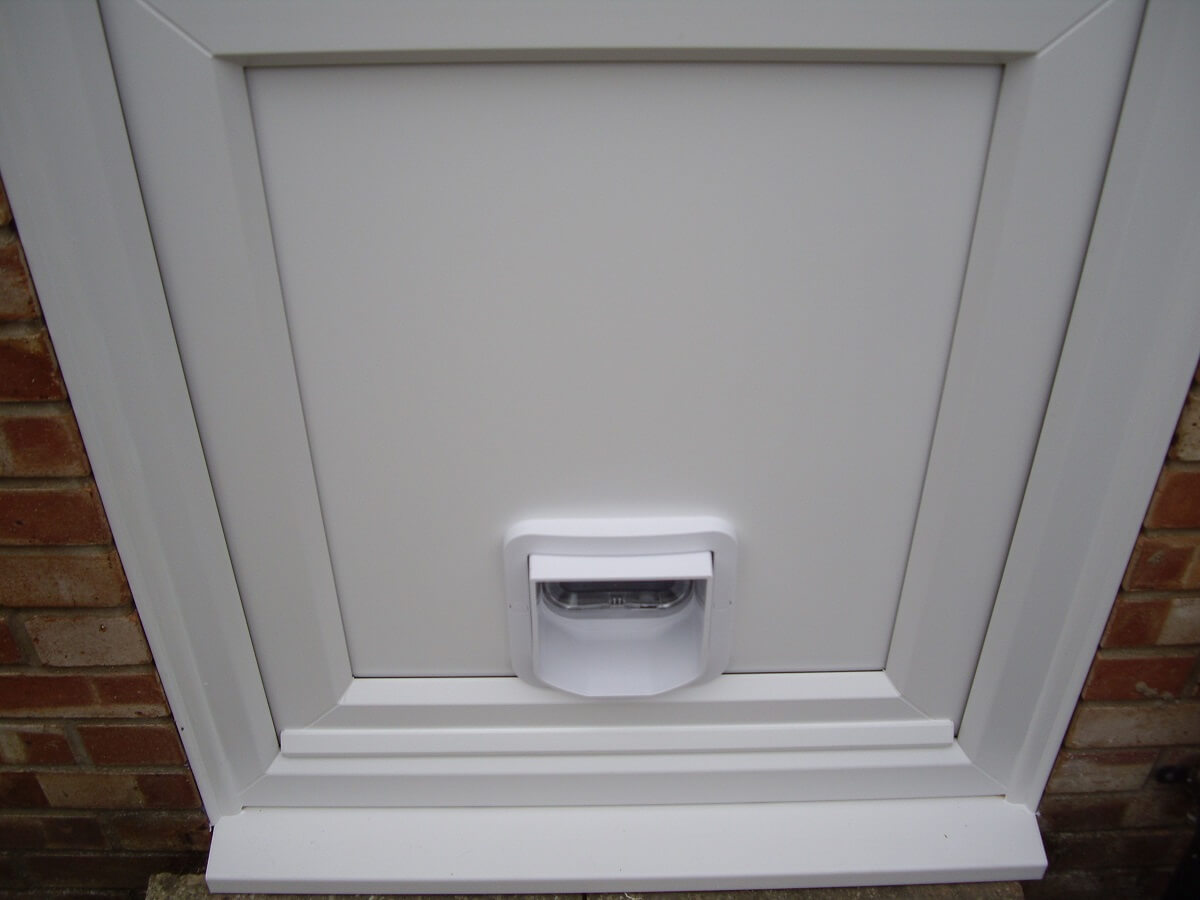 Cat flap into PVCu panel