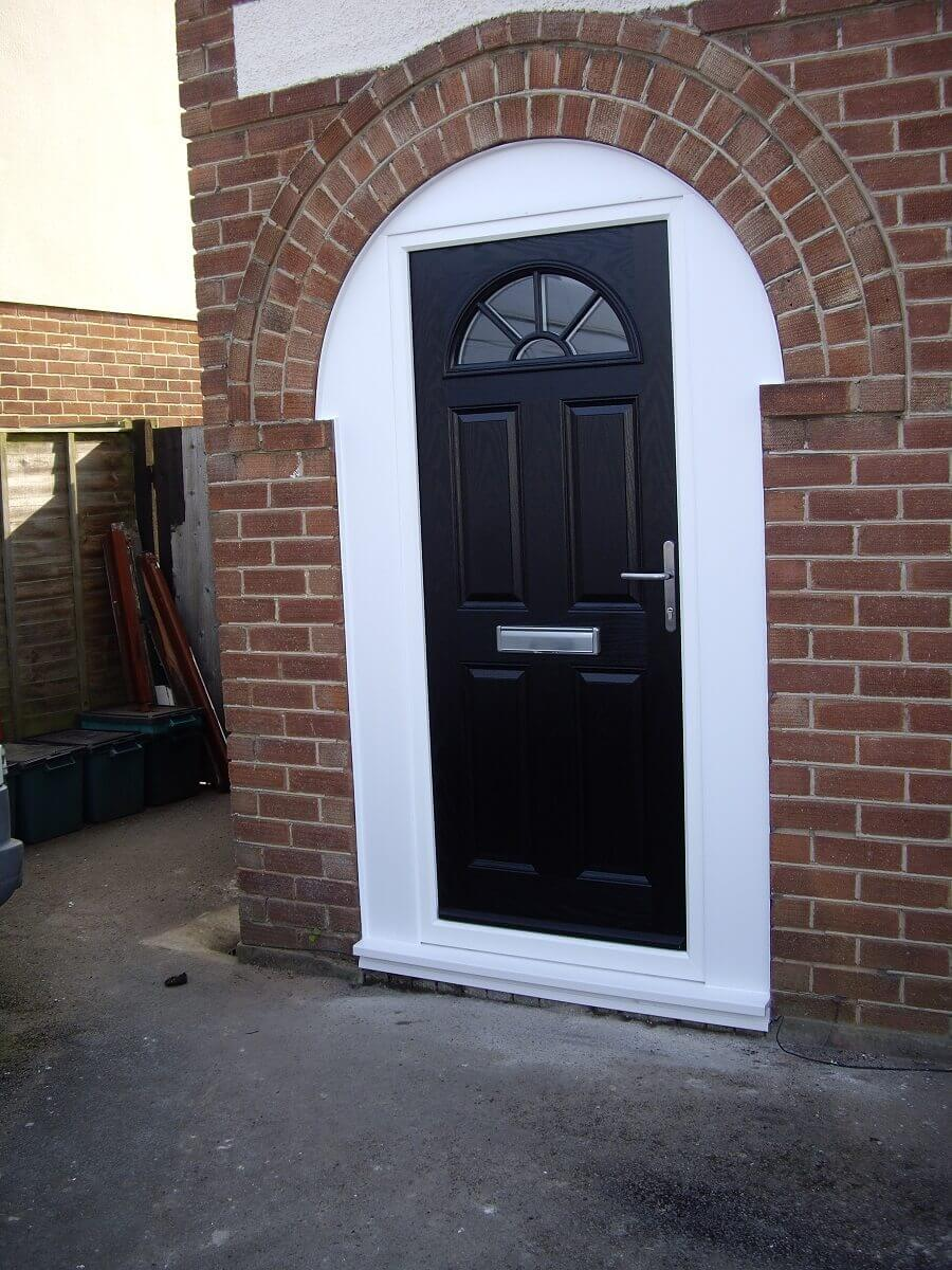 Composite door with exterior shaped cladding