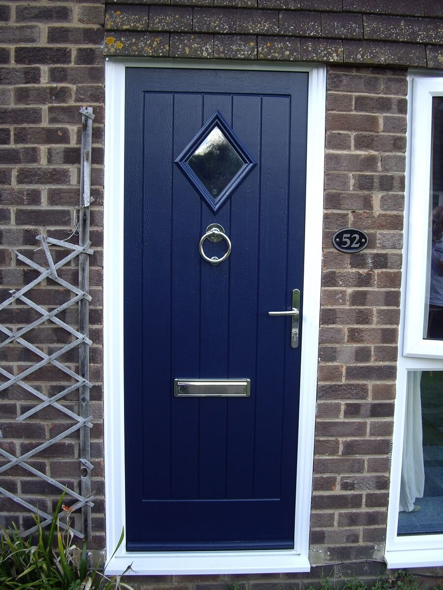 Endurance French Navy Cleeve door with bull ring knocker, classic lever lever handle and letter box