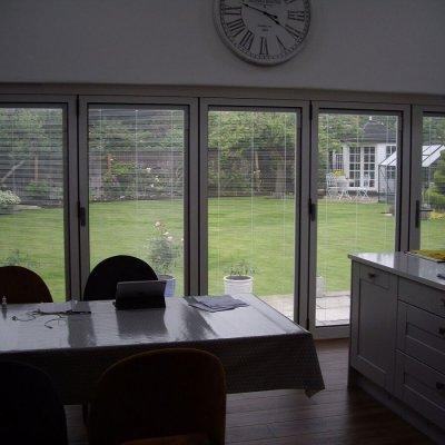 Internal view of bi-folding doors with integral blinds