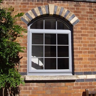 Silver grey arched top window