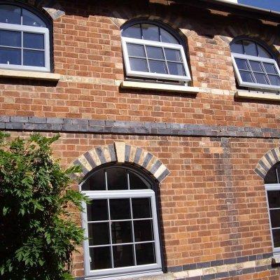 Silver grey arched top windows