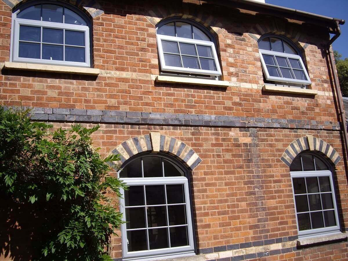 Silver grey arched top windows
