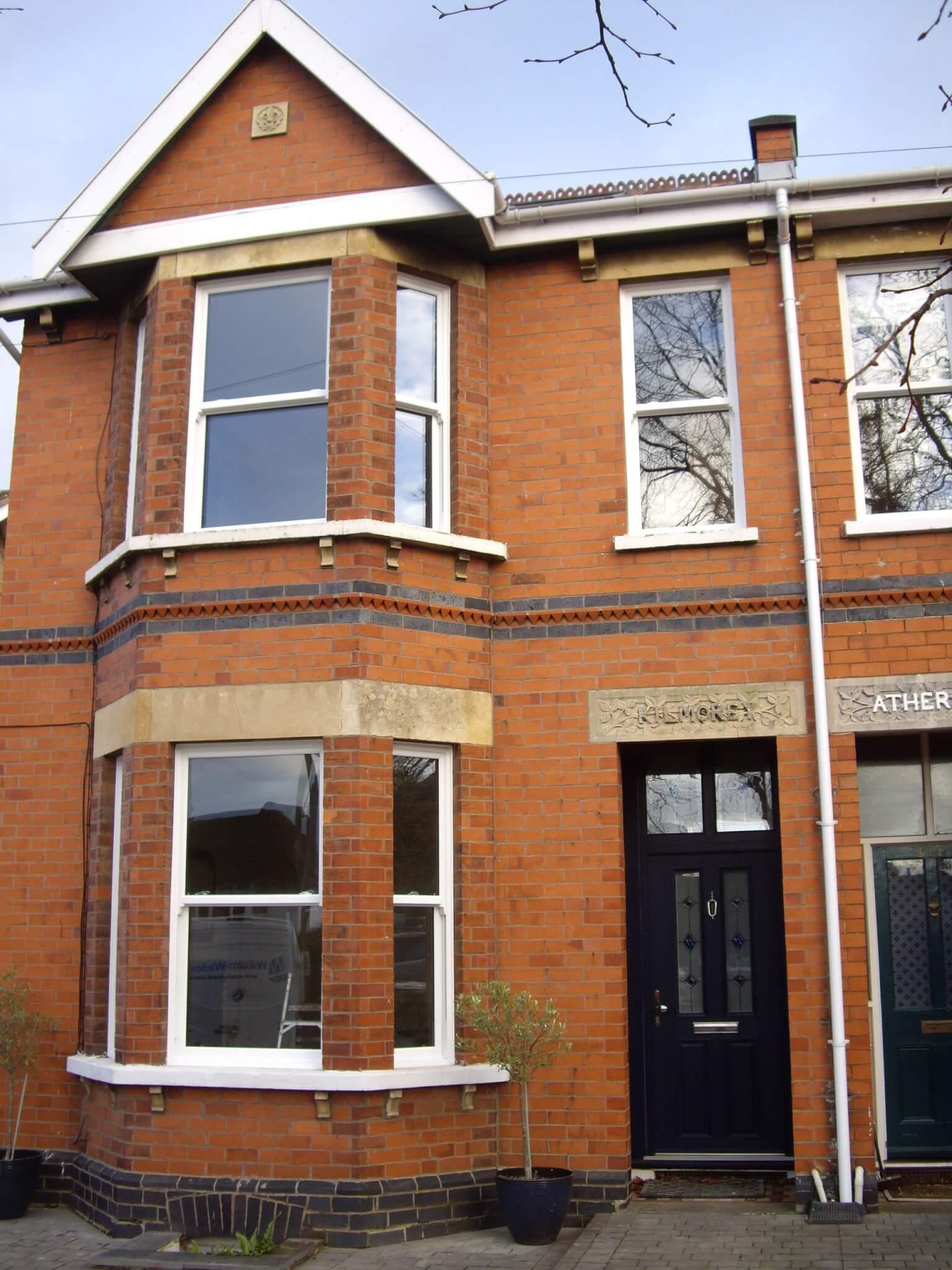 Sliding Sash windows across whole house installed behind the brick line