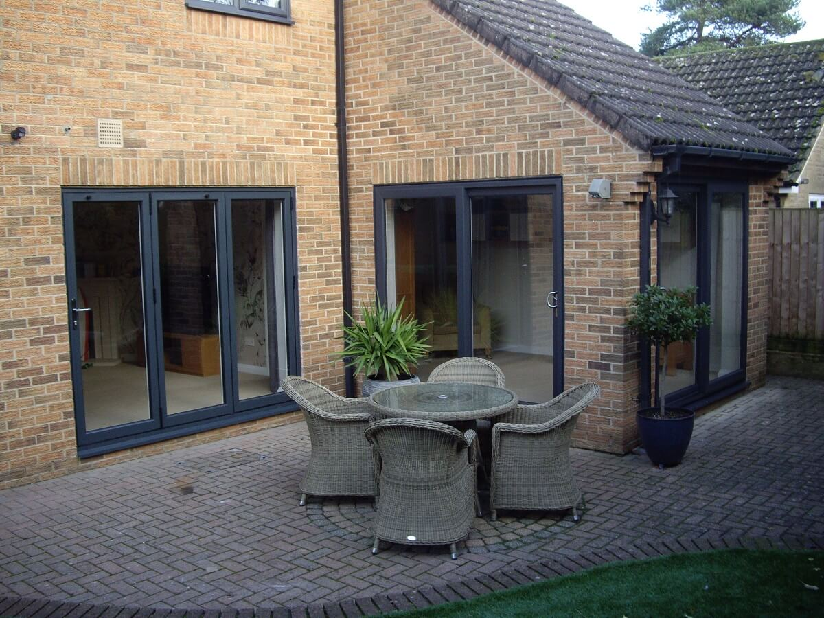 Sliding patio doors complementing bi-folding doors