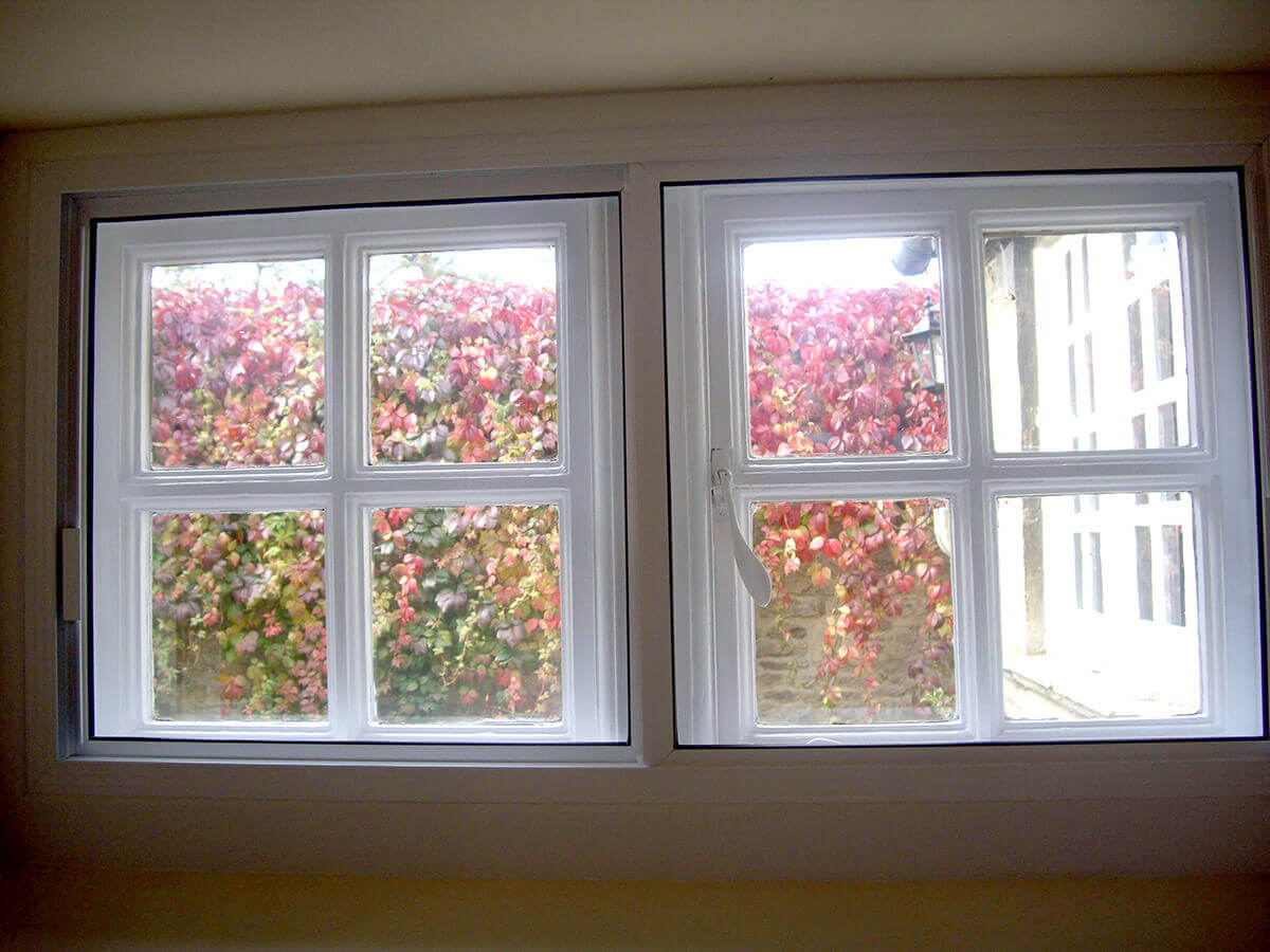 Sliding secondary glazing for near invisibe security and insulation