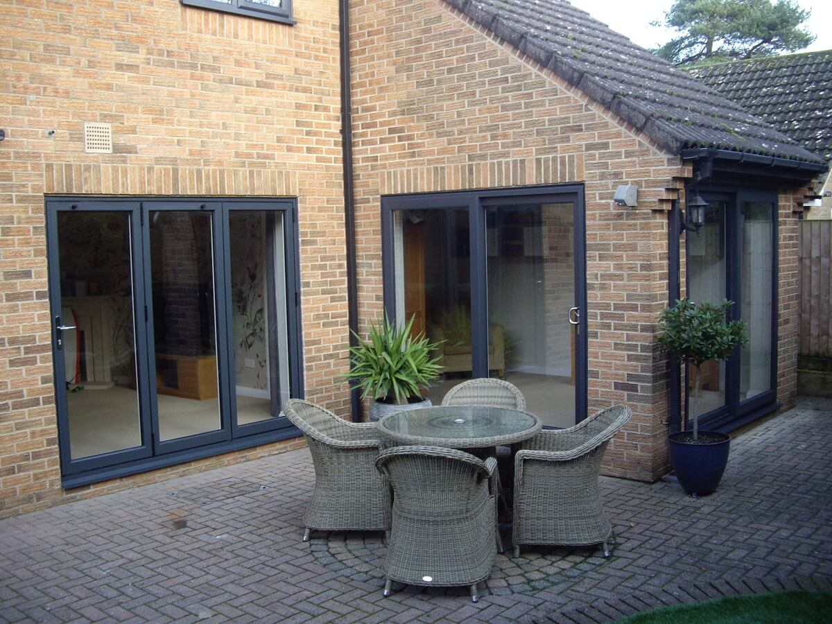 The ever popular Anthracite Grey bi-folding doors with adjacent sliding patio doors