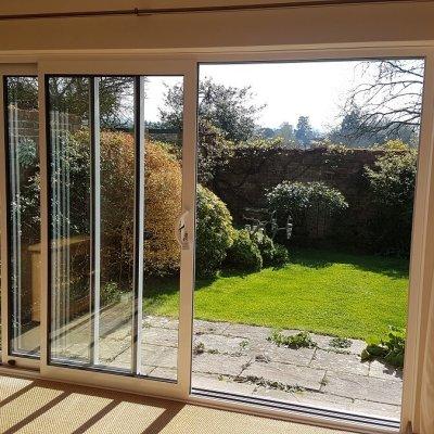 Triple track aluminium sliding patio doors (internal open)