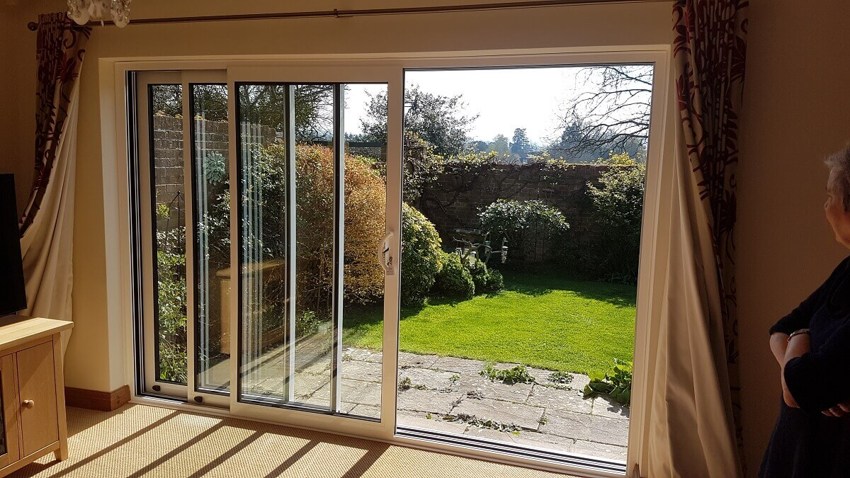 Triple track aluminium sliding patio doors (internal open)